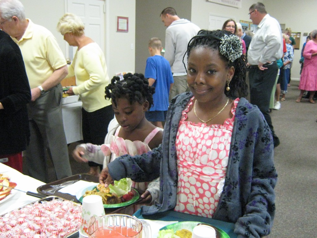 Girls from Immokalee getting food at Grace Lutheran Naples