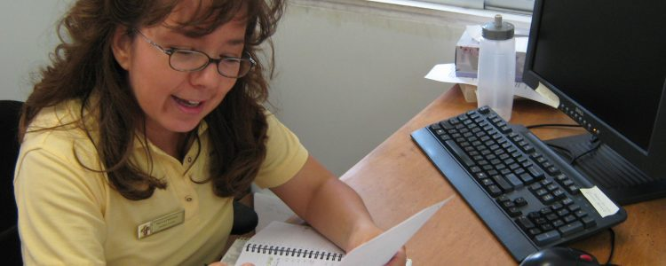 Marisol helping client